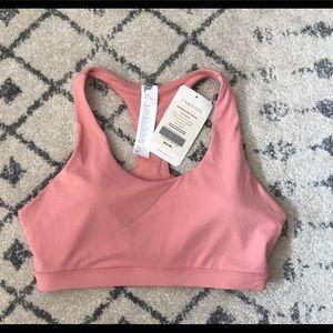 Light pink sports bra. Size medium.